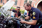 09/25/2011 - Medford/Somerville, Mass. - Kids were able to sit on a Tufts University Police motorcycle during Tufts University's Community Day on Sunday, September 25, 2011. (Everett Wallace for Tufts University)