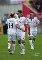 25 April 2010: Toronto FC defender Adrian Cann #12 celebrates a goal by Toronto FC midfielder Dwayne De Rosario #14 during a game between the Seattle Sounders and Toronto FC at BMO Field in Toronto..Toronto FC won 2-0....