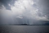 Snow storm over small island on Norwegain coast