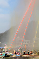 """A finale of coloured hose water. Housui Gassen (fire-hose battle), Bizen city, Okayama pref, Japan, February 2, 2014. The annual Bizen """"Housui Gassen"""" (fire-hose battle) takes place in the Hinase port area. Opposing teams of fire-fighters spray each other with hoses before the event culminates with a display of coloured water from the hoses."""