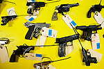 New Jersey, United States. 15th February 2013 -- Weapons with tags are soon on a table after being acquired during the Gun Buyback program in New Jersey. Photo by Eduardo Munoz Alvarez / VIEWpress.