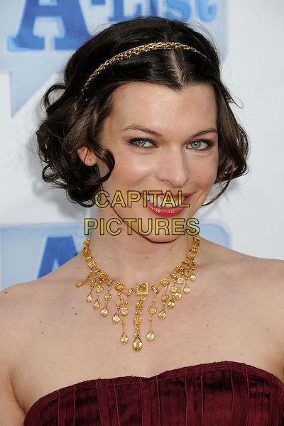 "MILLA JOVOVICH.Bravo's 2nd Annual ""The A-List Awards"" held at The Orpheum Theatre, Los Angeles, CA, USA..April 5th, 2009.headshot portrait red burgundy maroon necklace strapless gold chain hairband .CAP/ADM/BP.©Byron Purvis/AdMedia/Capital Pictures."