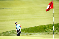 Gregory Bourdy chips in his third shot from outside the 18th green during the 2016 U.S. Open in Oakmont, Pennsylvania on June 18, 2016. (Photo by Jared Wickerham / DKPS)