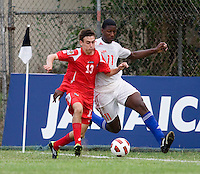 Daniel Luis Saez (11) of Cuba fights for the ball with Francisco Narbon (13) of Panama during the group stage of the CONCACAF Men's Under 17 Championship at Jarrett Park in Montego Bay, Jamaica. Panama tied Cuba, 0-0.