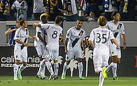CARSON, CA - May 26, 2012: LA Galaxy defender Sean Franklin (5) celebrates his goal with his teammates during the LA Galaxy vs Seattle Sounders match at the Home Depot Center in Carson, California. Final score, LA Galaxy 4, Seattle Sounders 0.