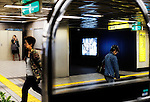 Commuters walk through an underground station in Tokyo, Japan.