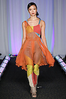 Model walks runway in an outfit by LaTimbery Simone Johnson, for the Syracuse University, College of Visual and Peforming Arts 2011 Fashion Show Gala.
