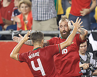 Portugal midfielder Raul Meireles (16) celebrates his goal with teammates. In an international friendly, Brazil (yellow/blue) defeated Portugal (red), 3-1, at Gillette Stadium on September 10, 2013.