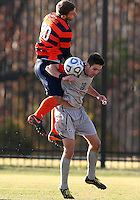 WASHINGTON, DC - NOVEMBER 25, 2012: Steve Neumann (18) of Georgetown University is hit in the back by Chris Makowski (20) of Syracuse University during an NCAA championship third round match at North Kehoe field, in Georgetown, Washington DC on November 25. Georgetown won 2-1 after overtime and penalty kicks.