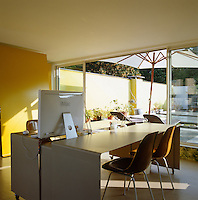 The garden room also serves as an office where a series of sliding doors can open an entire wall to the adjacent terrace