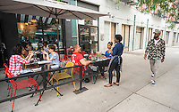 Sidewalk cafe in Harlem in New York on Saturday, June 11, 2016. (© Richard B. Levine)