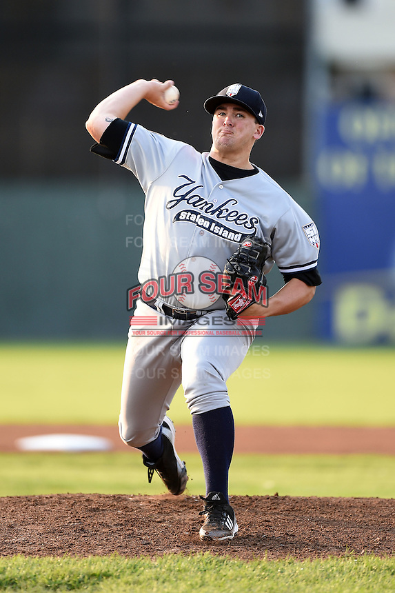 Staten Island Yankees pitcher Jonathan Holder (60) delivers a pitch during a game against the Batavia Muckdogs on August 8, 2014 at Dwyer Stadium in Batavia, New York.  Staten Island defeated Batavia 4-2.  (Mike Janes/Four Seam Images)