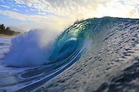 Evening light on a perfect wave at sunset at Rockpiles, North Shore, O'ahu.