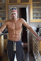 sexy shirtless All American man at home wearing an American Flag hat