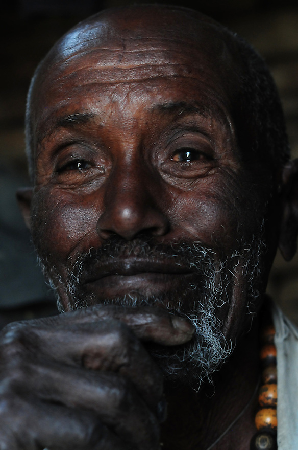 Luvolo is a recipient of a CCC elder grant of 150 birr per month. The Community Care Coalitions throughout the Tigray region  have formalized traditional ways of community social protection for a populations most vulnerable..Luvolo is 78 years old. He receives an elder grant from the CCC. He spends the 150 birr each month on clothing, cooking oil and grains. Before the CCC stepped in, he would beg from other homes in the area..The Community Care Coalitions throughout the Tigray region  have formalized traditional ways of community social protection for a populations most vulnerable. ..Luvolo is 78 years old. He receives an elder grant from the CCC. He spends the 150 birr each month on clothing, cooking oil and grains. Before the CCC stepped in, he would beg from other homes in the area..