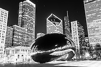 "Cloud Gate Chicago Bean black and white picture at night. Frequently called ""The Bean"" for its bean shape,  Cloud Gate was created by Anish Kapoor and is located in Millennium Park in Grant Park in the downtown Chicago Loop."