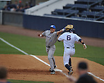 Ole Miss' Blake Newalu (6) is safe at first on an error  vs. Memphis' T.J. Rich (19) at Oxford-University Stadium in Oxford, Miss. on Tuesday, February 28, 2012. Ole Miss won 7-2.