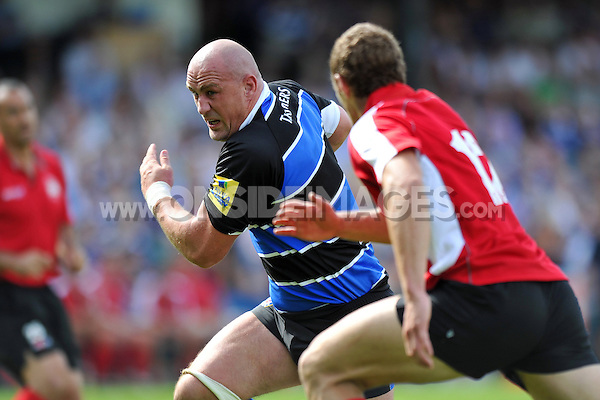 Carl Fearns charges through the London Welsh defence. Pre-season friendly match, between Bath Rugby and London Welsh on August 11, 2012 at the Recreation Ground in Bath, England. Photo by: Patrick Khachfe / Onside Images