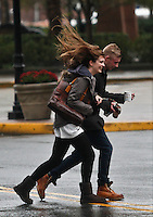 A couple walks pass as Hurricane Sandy begins to affect the area in Newport New Jersey United States. 29/10/2012. Photo by Kena Betancur/VIEWpress.
