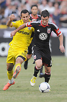 D.C. United forward Chris Pontius (13) shields the ball from Columbus Crew midfielder Justin Meram (9)  D.C. United defeated The Columbus Crew 1-0 at RFK Stadium, Saturday August 4, 2012.