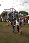 Chile, Easter Island:  People gather outside the Catholic Church in Hanga Roa after Sunday morning mass..Photo #: ch347-33577.Photo copyright Lee Foster www.fostertravel.com lee@fostertravel.com 510-549-2202