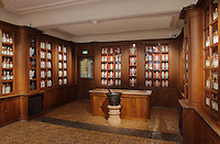 Pharmacy, with 130 earthenware pots dating from 1782, holding ointments, oils, pills and syrups, and glass jars with more unusual ingredients, in Les Hospices de Beaune, or Hotel-Dieu de Beaune, a charitable almshouse and hospital for the poor, built 1443-57 by Flemish architect Jacques Wiscrer, and founded by Nicolas Rolin, chancellor of Burgundy, and his wife Guigone de Salins, in Beaune, Cote d'Or, Burgundy, France. The hospital was run by the nuns of the order of Les Soeurs Hospitalieres de Beaune, and remained a hospital until the 1970s. The building now houses the Musee de l'Histoire de la Medecine, or Museum of the History of Medicine, and is listed as a historic monument. Picture by Manuel Cohen
