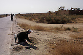 Kabul, Afghanistan<br /> November 21, 2001<br /> <br /> A Halo landmine sweeper works along the Bagram-Kabul road that was until last week the front line between the Taliban and the Northern Alliance warring parties.
