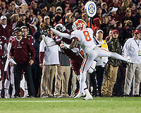 The tenth ranked South Carolina Gamecocks host the 6th ranked Clemson Tigers at Williams-Brice Stadium in Columbia, South Carolina.  USC won 31-17 for their fifth straight win over Clemson.  South Carolina Gamecocks wide receiver Shaq Roland (4) catches the ball over Clemson Tigers cornerback Darius Robinson (8) as South Carolina Gamecocks head coach Steve Spurrier looks on.