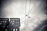Overhead trolley wires and buildings on a stormy night