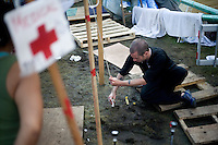 A man anchors the medical tent at the OccupyBoston demonstration in Dewey Square in the Financial District of downtown Boston, Massachusetts, USA. The protesters are part of  OccupyBoston, which is part of the OccupyWallStreet movement, expressing discontent with the socioeconomic situation of the 99% of the US population who are not wealthy.  Protestors have been camping in Dewey Square since Sept. 30, 2011. Gradually, larger organizations, including major labor unions, have expressed their support for the OccupyBoston effort.  On this day, Oct. 5, members of National Nurses United, the largest nurses' union in the US, marched alongside the OccupyBoston protesters.