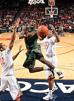 CHARLOTTESVILLE, VA- JANUARY 7: Durand Scott #1 of the Miami Hurricanes shoots between Malcolm Brogdon #22 and Akil Mitchell #25 of the Virginia Cavaliers during the game on January 7, 2012 at the John Paul Jones Arena in Charlottesville, Virginia. Virginia defeated Miami 52-51. (Photo by Andrew Shurtleff/Getty Images) *** Local Caption *** Akil Mitchell;Malcolm Brogdon;Durand Scott