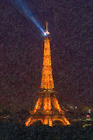 The Eiffel Tower with rotating beacon at night in Paris, France. The image was creatively modified to resemble a painting.