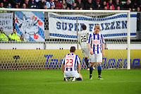 VOETBAL: HEERENVEEN: Abe Lenstra Stadion, SC Heerenveen - Vitesse, 21-01-2012, Eindstand 1-1, Ramon Zomer (#23), Doke Schmidt (#36), teleurstelling na de gelijkmaker, ©foto Martin de Jong