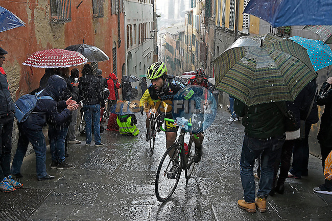 A wet day for the 5000 riders on the final 17% climb of Via Santa Caterina in Siena of the 2017 Strade Bianche Gran Fondo by Trek, running 127km from Siena to Siena, Tuscany, Italy 5th March 2017.<br /> Picture: La Presse/Fabio Ferrari | Newsfile<br /> <br /> <br /> All photos usage must carry mandatory copyright credit (&copy; Newsfile | La Presse)