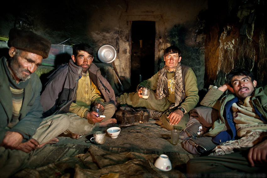 Wakhi men having diner of salty tea and bread, in a winter shepherd house. Chirog Don shepherd place...Trekking up the Wakhan frozen river, the only way up to reach the high altitude Little Pamir plateau, home of the Afghan Kyrgyz community.