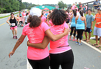 Olivia Baker, right, and Silvia Martin, left, embrace after crossing the finish line during the 32nd annual Charlottesville Women's Four Miler race Saturday in Charlottesville, VA. Photo/The Daily Progress/Andrew Shurtleff