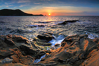 A soothing sunset over Campese bay, after a day of strong winds and storms. Taken an evening of mid September at Isola del Giglio, a small island part of the Tuscan Archipelago, Italy. This is stitched from four vertical takes.  This is stitched from four vertical frames.