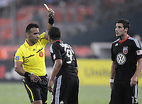 D.C. United forward Charlie Davies (9) gets a yellow card from referee Hilario Grajeda. D.C. United defeated The Vancouver Whitecaps FC 4-0 at RFK Stadium, Saturday August 13 , 2011.