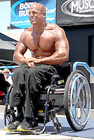 Wheelchair National Bodybuilder Champion and guest poser, Nick Scott, 29. flexes during the Muscle Beach International Classic in Venice on Monday, May 30, 2011.