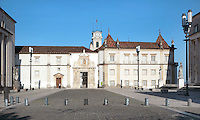 Library building with Porta Ferrea, designed 1634 by Antonio Tavares, at the University of Coimbra in the former Palace of the Alcazaba, Coimbra, Portugal. The Porta Ferrea is decorated with a statues by Manuel de Sousa of Wisdom, symbol of the University, and on either side, King John III or Joao III and King Denis I, founder of the University. The University of Coimbra was first founded in 1290 and moved to Coimbra in 1308 and to the royal palace in 1537. In the distance is the University clock tower. The buildings are listed as a historic monument and a UNESCO World Heritage Site. Picture by Manuel Cohen