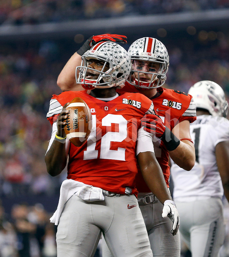 Ohio State Buckeyes quarterback Cardale Jones (12) celebrates his touchdown with Ohio State Buckeyes tight end Nick Vannett (81) against Oregon Ducks during the 2nd quarter in College Football Playoff Championship game at AT&T Stadium in Arlington, Texas on January 12, 2015.  (Dispatch photo by Kyle Robertson)