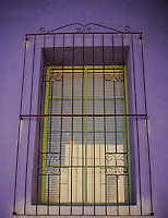 Purple Adobe - Green window with rusty grate - Arizona