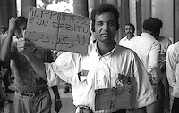 Roma  Giugno 1990.Ex Pastificio Pantanella occupato da centinaia di immigrati asiatici provenienti dal Pakistan e Bangladesh..Manifestazione degli abitanti della exPantanella in Campidoglio.Rome June 1990.Ex Pastificio Pantanella occupied by hundreds of Asian immigrants from Pakistan and Bangladesh..Demonstration of the inhabitants of the exPantanella in Capitol