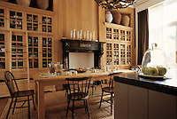 The large kitchen has a wall of contemporary floor to ceiling cupboards built around the original 19th century fireplace