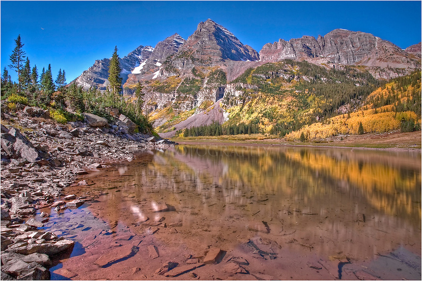 After an early morning of photographing the Maroon Bells by Maroon Lake, I made the short 2.3 mile walk to Crater Lake. There, I captured more images of this amazing landscape. The water was clear and there was a lot of gold in the Aspen and other trees. The iconic Bells are one of my favorite places to spend time anywhere in Colorado,and it is easy to see why they are the most photographed mountains in the state, as well.