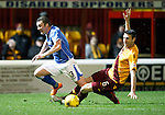 Motherwell v St Johnstone..30.12.15  SPFL  Fir Park, Motherwell<br /> Tam Scobbie is fouled by Stephen McManus<br /> Picture by Graeme Hart.<br /> Copyright Perthshire Picture Agency<br /> Tel: 01738 623350  Mobile: 07990 594431