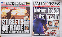 The New York Daily News and the New York Post report on Tuesday, November 25, 2014 about the rioting in Ferguson, MO after the Grand Jury did not indict Police Officer Darren Wilson in the death of Michael Brown.   (© Richard B. Levine)