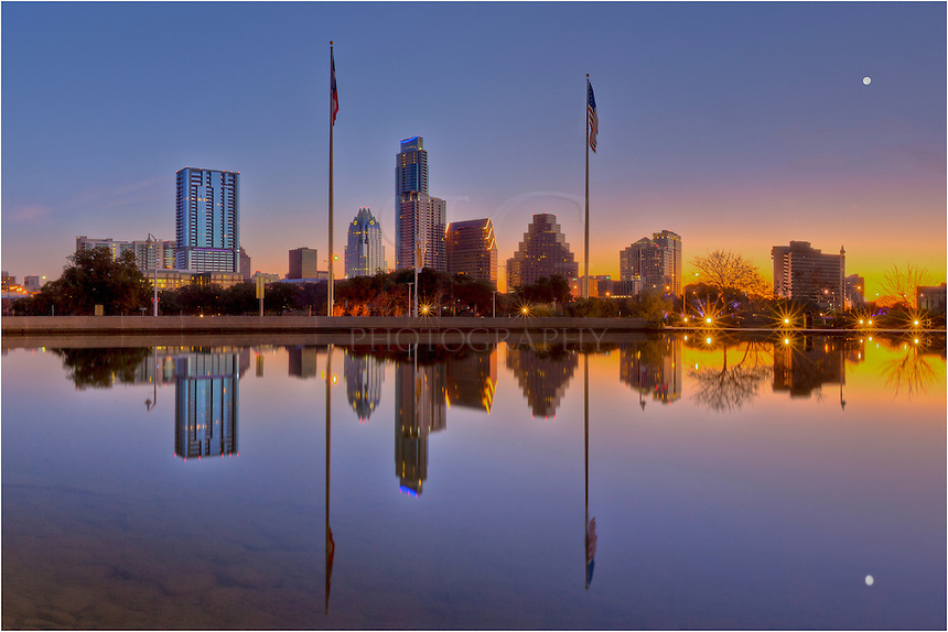 Well before sunrise, the waters of the pool in front of the Long Center were calm. The reflection of the Austin Skyline and rising moon are clear in the still waters. I think everyone in Austin was still asleep when I was out photographing this image.
