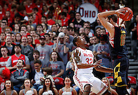 Maryland Terrapins guard/forward Jake Layman (10) looks for an open man under pressure from Ohio State Buckeyes guard Lenzelle Smith Jr. (32) in the second half of the college basketball game between the Ohio State Buckeyes and the Maryland Terrapins at the Jerome Schottenstein Center in Columbus, Wednesday evening, December 4, 2013. The Ohio State Buckeyes defeated the Maryland Terrapins 76 - 60. (The Columbus Dispatch / Eamon Queeney)