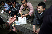 Rural workers gather at a labor market in the southwestern Chinese megapolis of Chongqing in search of jobs as chefs. <br /> <br /> They are holding placards stating the dishes they can cook. The cooks say when they can get a job they earn 2,000 - 7,000 yuan per month, a phenomenal improvement over tilling the fields. <br /> <br /> Urbanization has already proven to be one of the most wrenching changes in China&rsquo;s 35 years of economic reforms. Land disputes rising from urbanization account for tens of thousands of protests each year. protests each year.